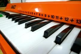 Orange electric keyboard in Becnicks