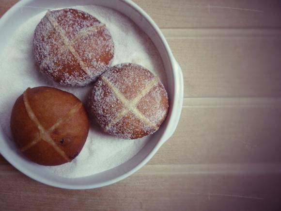 rolling the doughnuts in sugar